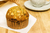 Almond muffins with coffee cup on wood table — Stock Photo
