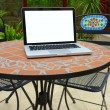 Summer terrace on the table laptop - Stock Photo