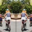 Mother and two children cycling — Stock Photo