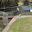 A lock gate on a canal on the inland waterways network — Stock Photo