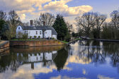 Houses by canal — Stock Photo