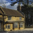 A traditional english pub on a street in a village — Stock Photo
