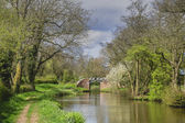 A canal on the inland waterways network of navigable canals and waterways in the english and british countryside in the uk, united kingdom, great britain, europe — Stock Photo