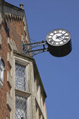 Antique clock on a building. Ancient brick wall — Stock Photo