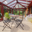 Conservatory tables chairs plants room — Stock Photo #47019235