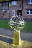 Metal sculpture of globe — Stock Photo