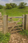 A gate on a footpath. — Stock Photo