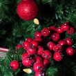 Red holiday berries and ornaments — Stock Photo #15383955