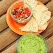 Stock Photo: Guacamole with chips and salsa