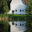 White barn on a farm in the country - Stock Photo