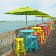 Colorful chairs overlooking ocean - Stock Photo