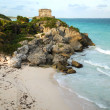 Mayan ruin on cliff overlooking beach - Stock Photo