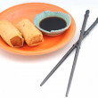 Pair of egg rolls with chopsticks — Stock Photo