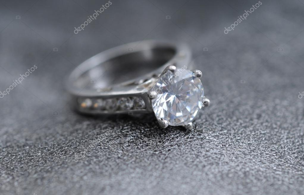 Diamond ring on elegant gray leather background — Stock Photo #19661385