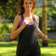 Young woman getting in shape by running — Stock Photo
