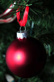 Matte red holiday ornament — Stock Photo