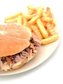 Shredded pork sandwich and fries — Stock Photo