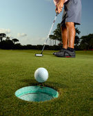 Golfer on a course golfing — Stock Photo