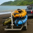 Kayaks being pulled up to ocean on trailer — Stock Photo