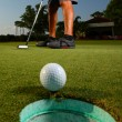 Stock Photo: Golfer golfing and close-up of golf ball