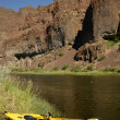 Stock Photo: Kayak with nobody on river in Oregon with mountains