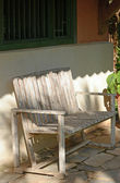 Empty Rustic wooden bench in front of home in panama — Stock Photo