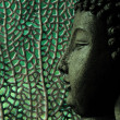 Tropical and serene buddha with oceanic background in green — Stock Photo