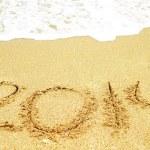 Celebrate 2014 on the beach — Stock Photo