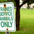 Trained service animals only sign at park in summer — Stock Photo