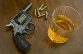 Deadly combination of alcohol and firearms — Stock Photo