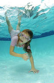 Cute young girl swimming — Stock Photo