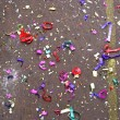 Colorful confetti in street — Stock Photo