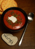 Tomato soup and warmth on wood — Stock Photo