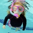 Pretty child swimming in pool — Stock Photo