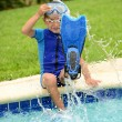Child splashing feet in pool — Stock Photo