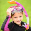 Smiling young girl with swimming goggles and snorkel — Stock Photo