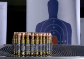 Bullets and bullseye target — Stock Photo