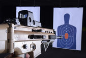 Machine gun pointed at bullseye target on gun range — Stock Photo