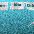 Peace love and kindness girl dancing on ocean background — Stok fotoğraf
