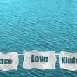 Peace, love and kindness on ocean background — 图库照片