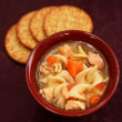 Comfort food and chicken noodle soup — Stock Photo #33786245