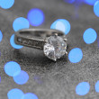 Stock Photo: Diamond engagement ring with blue abstract lights