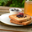 Toast with jam outdoors — Stock Photo #34645005
