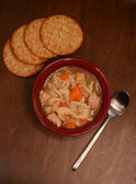 Chicken noodle soup and crackers — Stock Photo