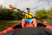 Man in red kayak — Stock Photo