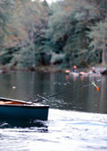 Fishing in a canoe in autumn in maine — Stock Photo