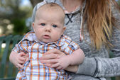 Baby with blue eyes and a dazed expression — Stock Photo