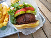 Vegetarian mushroom burger and fries — Stock Photo