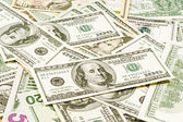 American dollar bills scattered in a chaotic manner — Stock Photo