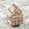 Stock Photo: House of matches on the dollar bills